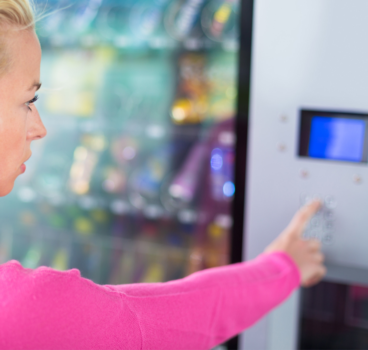 Woman at an office vending machine